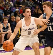 Furman senior  Andrew Brown (5) voluntarily surrended his starting job in order to make the Paladins stronger.