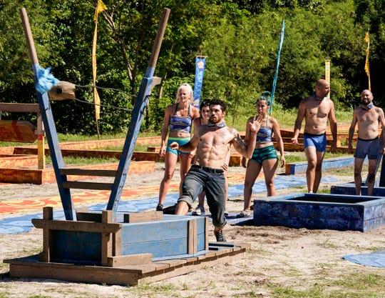 "Greenville's Chris Underwood competes in a reward challenge on Wednesday's episode of ""Survivor: Edge of Extinction."""