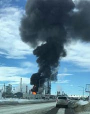 Flames and black smoke are seen at the Calumet Refinery in Great Falls Thursday afternoon.