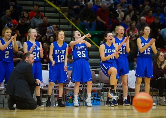 The Havre bench erupts after a basket late in Thursday's game against Libby during the Class A State Basketball Tournament in the Four Seasons Arena.