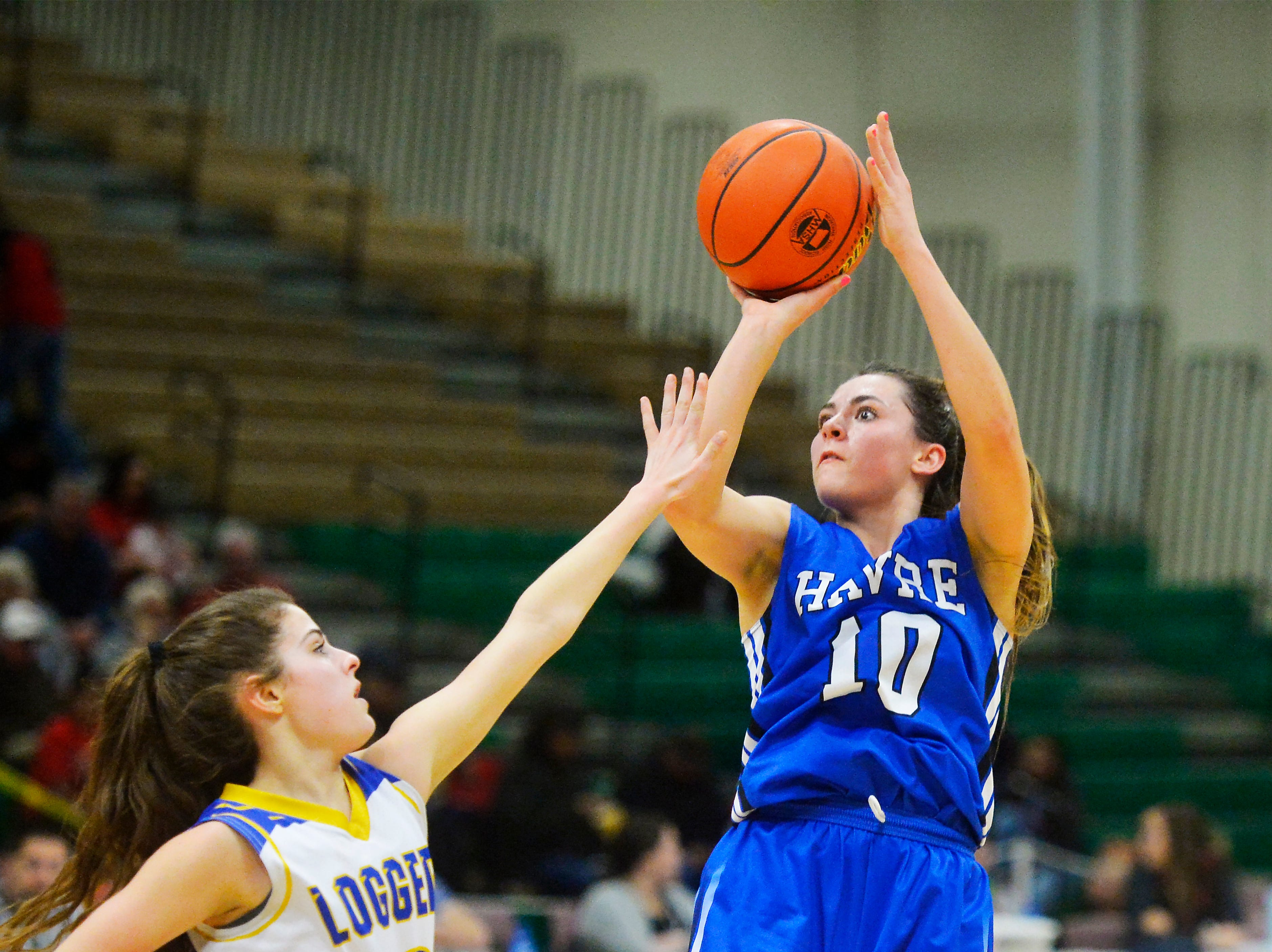Havre's Kyndall Keller shoots over Libby's Allie Collins on Thursday during the Class A State Basketball Tournament in the Four Seasons Arena.