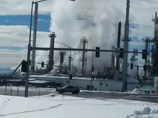 Water is sprayed on a fire at the Calumet Refinery in Great Falls Thursday.
