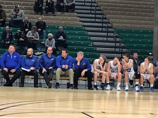 Head coach Cary Finberg (fifth from left) and his coaches and Columbia Falls Wildkats watch the action Thursday morning at Pacific Steel and Recycling Four Seasons Arena.
