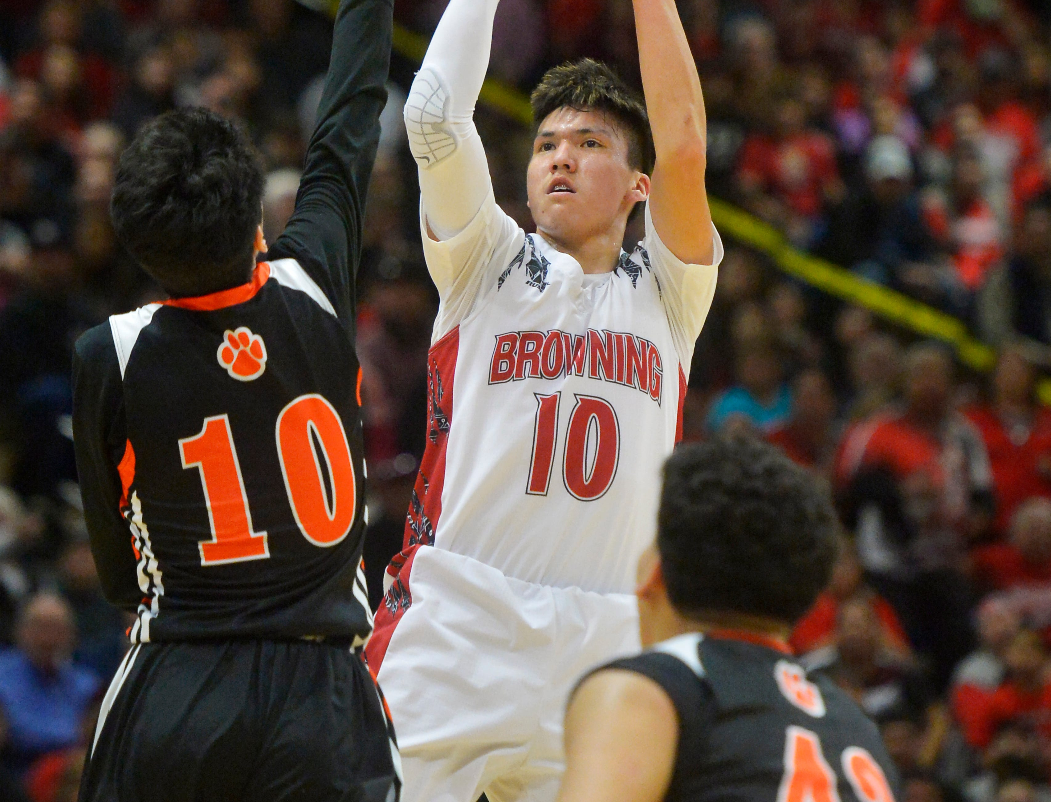 Browning's Riley Spoonhunter attempts a shot in Thursday's game against Hardin during the Class A State Basketball Tournament in the Four Seasons Arena.