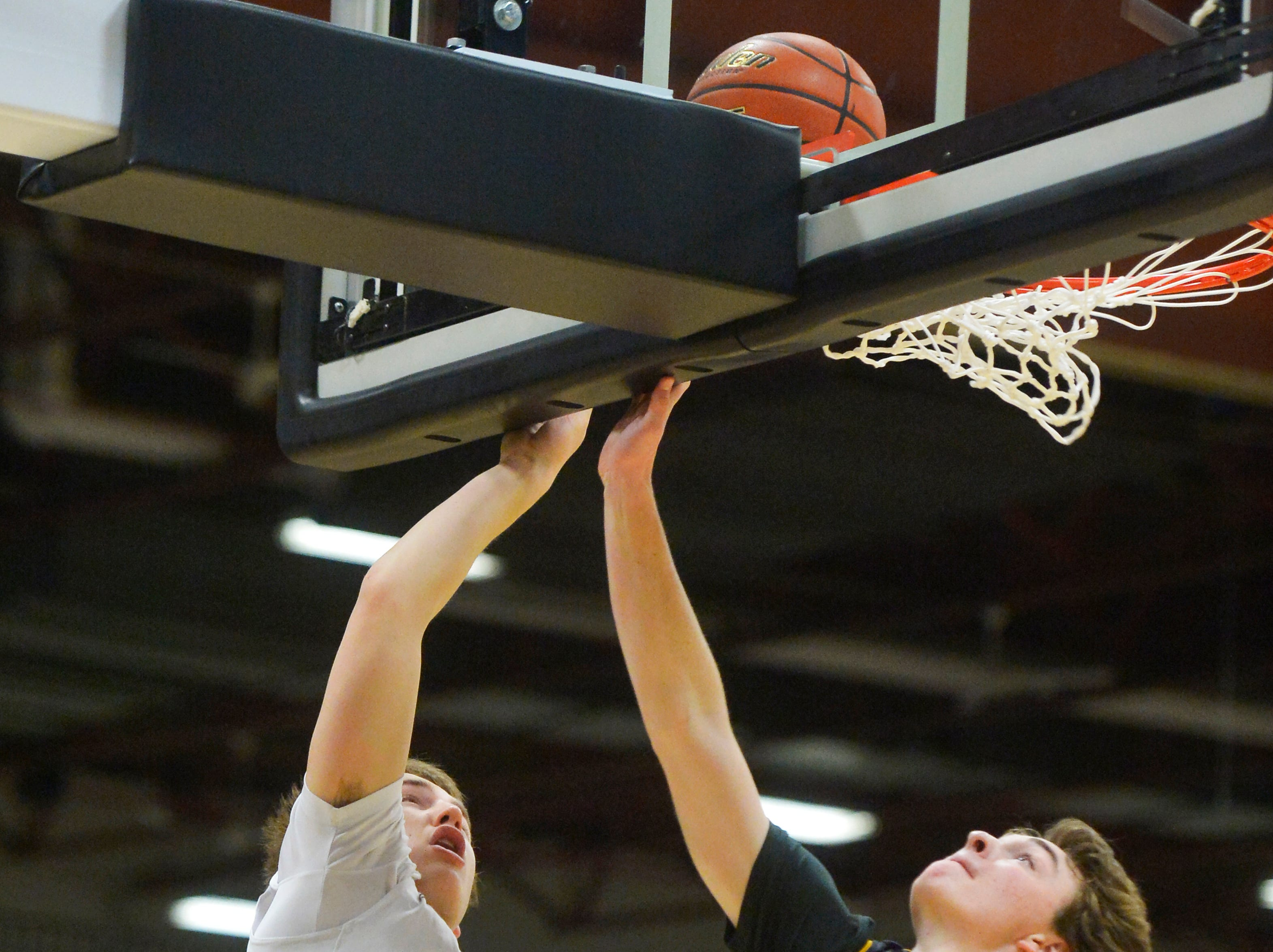Butte Central's Brad Harrington shoots a layup as Laurel's Gus Crowl defends during the Class A State Basketball Tournament, Thursday in the Four Seasons Arena.