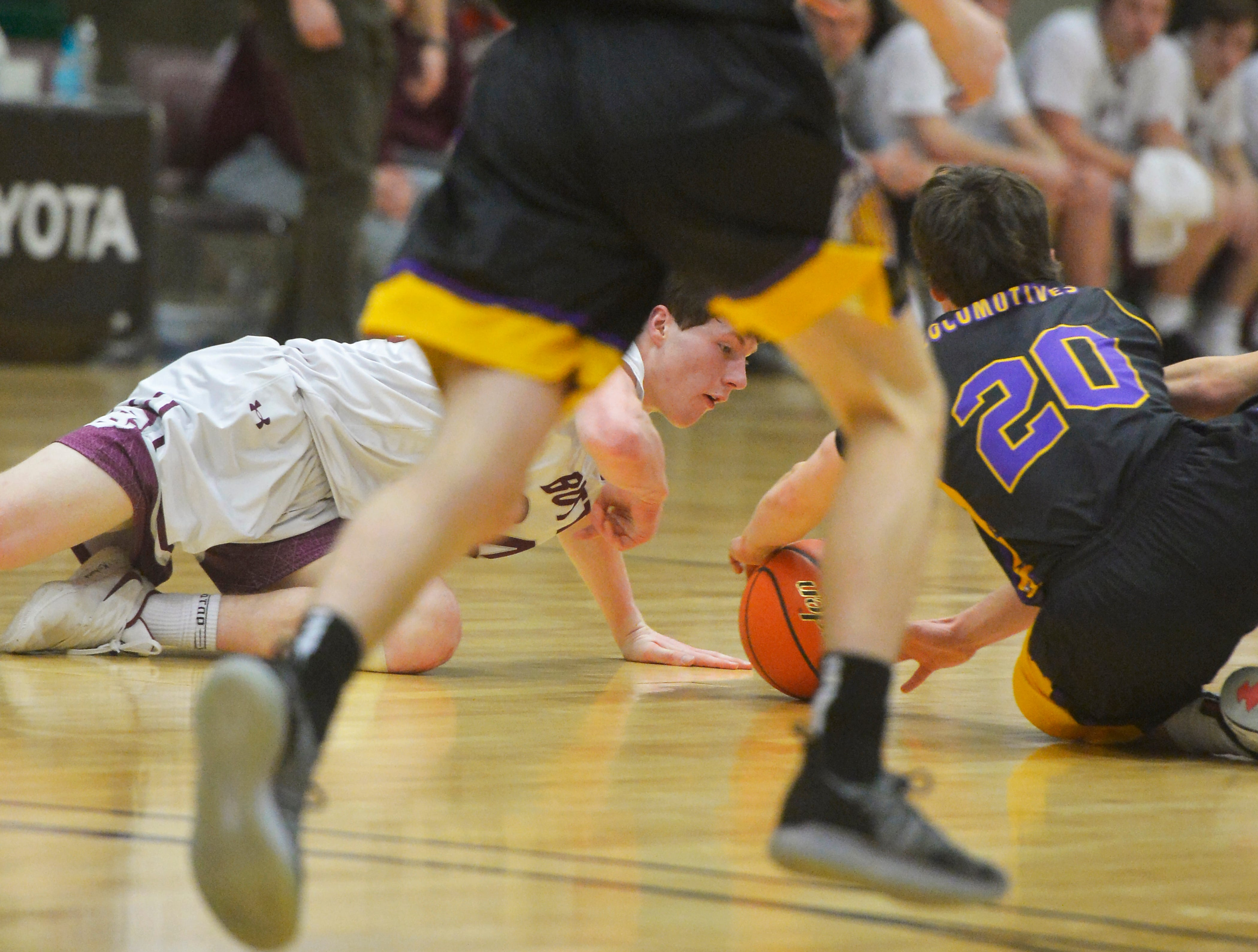 Butte Central's Cade Holter and Laurel's Eli Aby scramble for a loose ball during the Class A State Basketball Tournament on Thursday in the Four Seasons Arena.