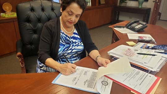 Gov. Lou Leon Guerrero on Thursday signs Bill 30 into law, which would allow government of Guam employees, retirees and their families an option to choose between Guam Memorial Hospital and Guam Regional Medical City.