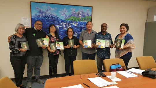 """Rlene Santos Steffy, author of CHamoru Children's Book and wildlife photographer, donated her first CHamoru Children's Book titled """"I Kareran Kotturan Gabrét Siha: I Piyitos NGånga' Siha"""" and her first wildlife booklet titled: """"Kakkak"""" to the Guam Public Library System on March 6. Pictured are GPLS board members and DCA/library staff from left: Teresita Kennimer (supervisor), Kyle Mandapat (board), Marissa Mears (board), Rlene Steffy (author), William Sarmiento (board), Kris Sereengan (board) and Anna Marie Arceo, DCA Mas Ge'hilo'."""