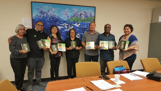 "Rlene Santos Steffy, author of CHamoru Children's Book and wildlife photographer, donated her first CHamoru Children's Book titled ""I Kareran Kotturan Gabrét Siha: I Piyitos NGånga' Siha"" and her first wildlife booklet titled: ""Kakkak"" to the Guam Public Library System on March 6. Pictured are GPLS board members and DCA/library staff from left: Teresita Kennimer (supervisor), Kyle Mandapat (board), Marissa Mears (board), Rlene Steffy (author), William Sarmiento (board), Kris Sereengan (board) and Anna Marie Arceo, DCA Mas Ge'hilo'."