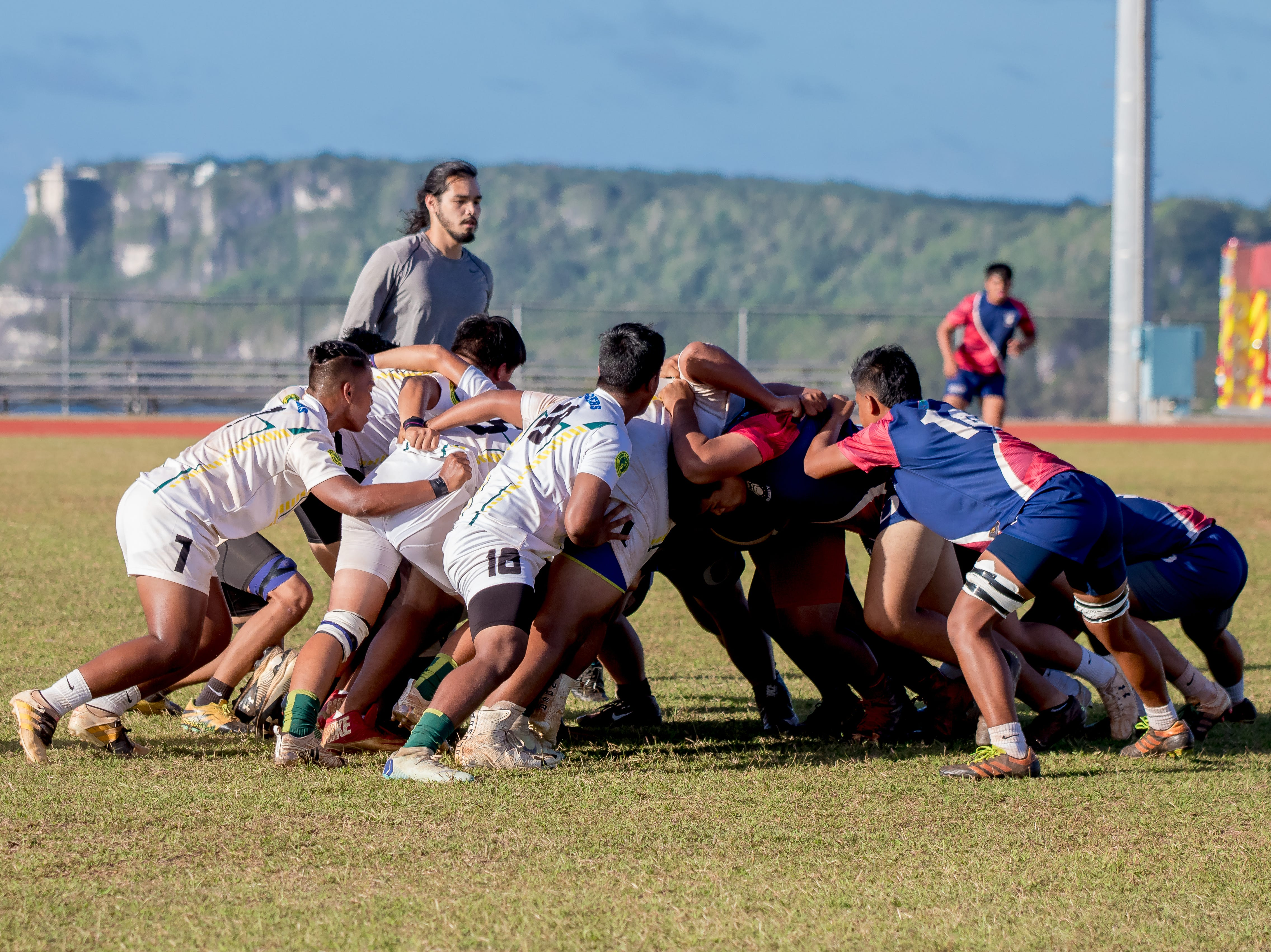 Players in action during a scrum at an IIAAG/GRFU Boys Rugby match at Ramsey Field on March 6.