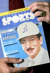 "Art Angotti holds a 1985 ""Indianapolis Sports Magazine"" with a cover story about his proposal for MLB team Indianapolis Arrows."