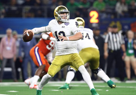 Ian Book is being asked to take more chances in the passing game by Notre Dame coaches.