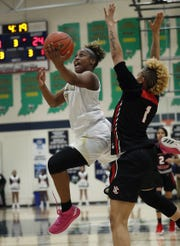 Warren Central guard Shaila Beeler (10) drives by North Central's Rikki Harris (1) in the second half of their sectional game on, Jan. 29, 2019.