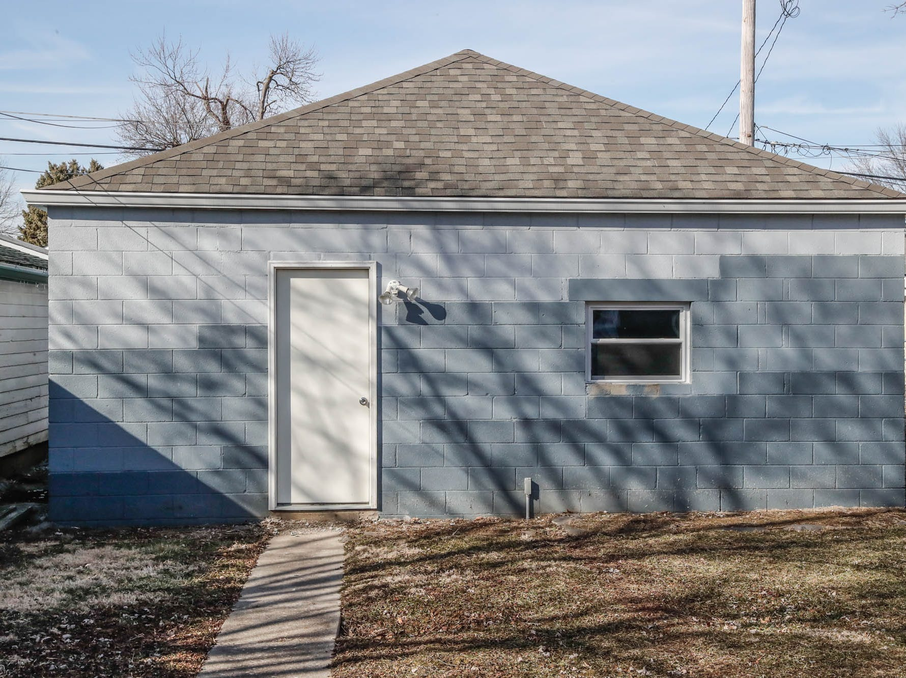 A newly remodeled home with an unattached garage, on Cruft St., affectionally known as the 'gray house' is part of the Big Car Collaborative and Riley Area Development affordable artist home ownership program on the near south side of Indianapolis on Wednesday, March 6, 2019. The renovation of this home was done by Axis Architecture and Big Car board member Ursula David. The goal of the Artist and Public Life Residency (APLR), will be to provide artists with home ownership while they work and collaborate with the greater community.