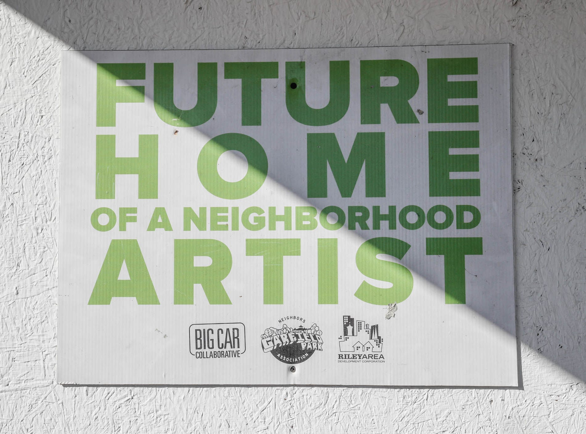 A sign hangs on the 'barn house'  on Cruft St., which will soon be renovated to be part of the Big Car Collaborative and Riley Area Development affordable artist home ownership program on the near south side of Indianapolis on Wednesday, March 6, 2019. The goal of the Artist and Public Life Residency (APLR), will be to provide artists with home ownership while they work and collaborate with the greater community.