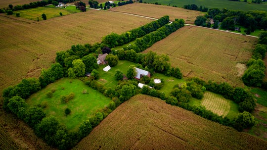 This historic Bargersville farmhouse sits on 7.4 acres and includes a century-old barn, grain silo, chicken coop and a small orchard.