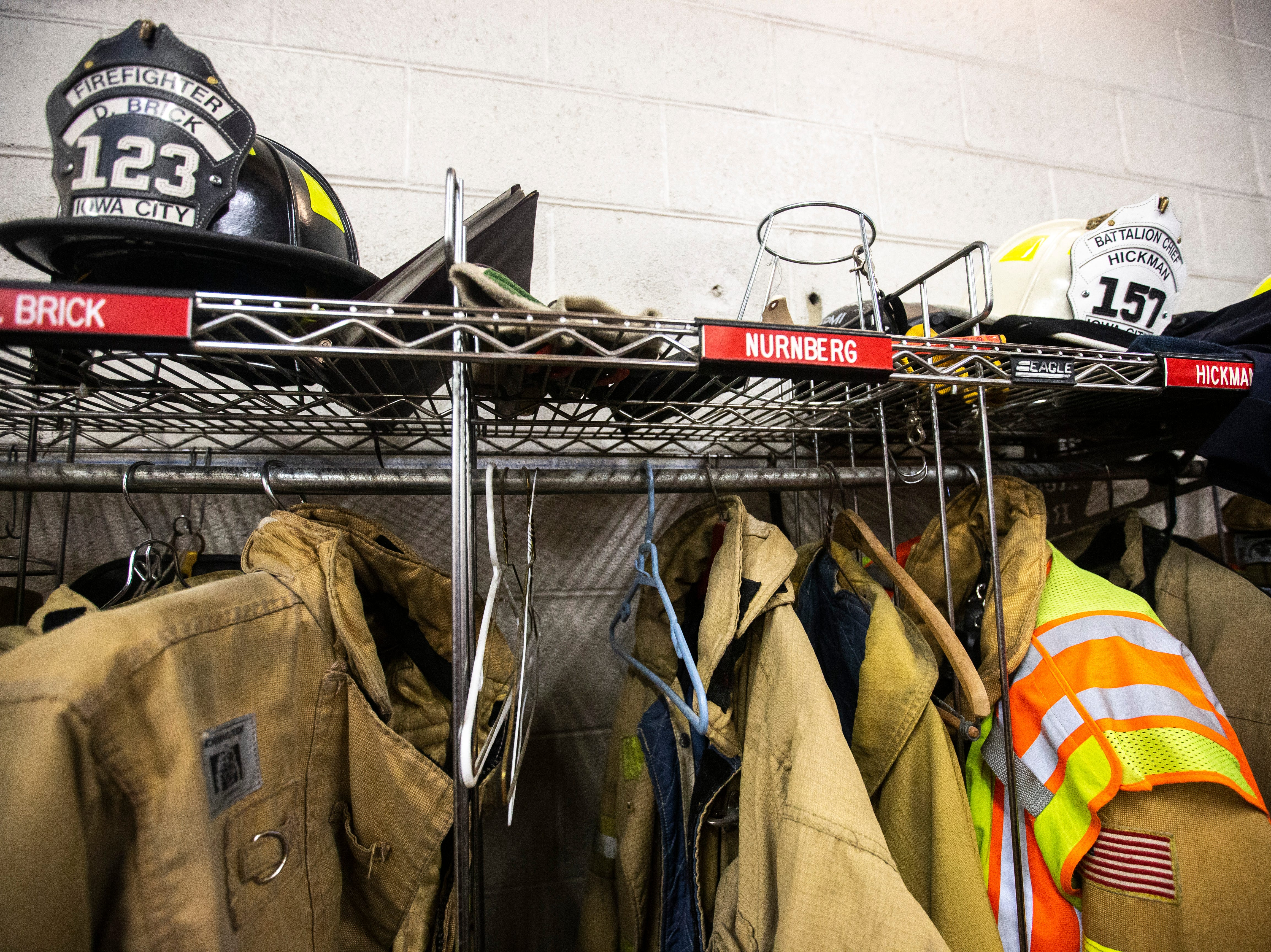 Equipment hangs in the garage on Thursday, March 7, 2019, inside Fire Station No. 1, at 10 South Gilbert Street in downtown Iowa City, Iowa. The station was opened January 1, 1961, the same day the previous station of 80 years was retired.