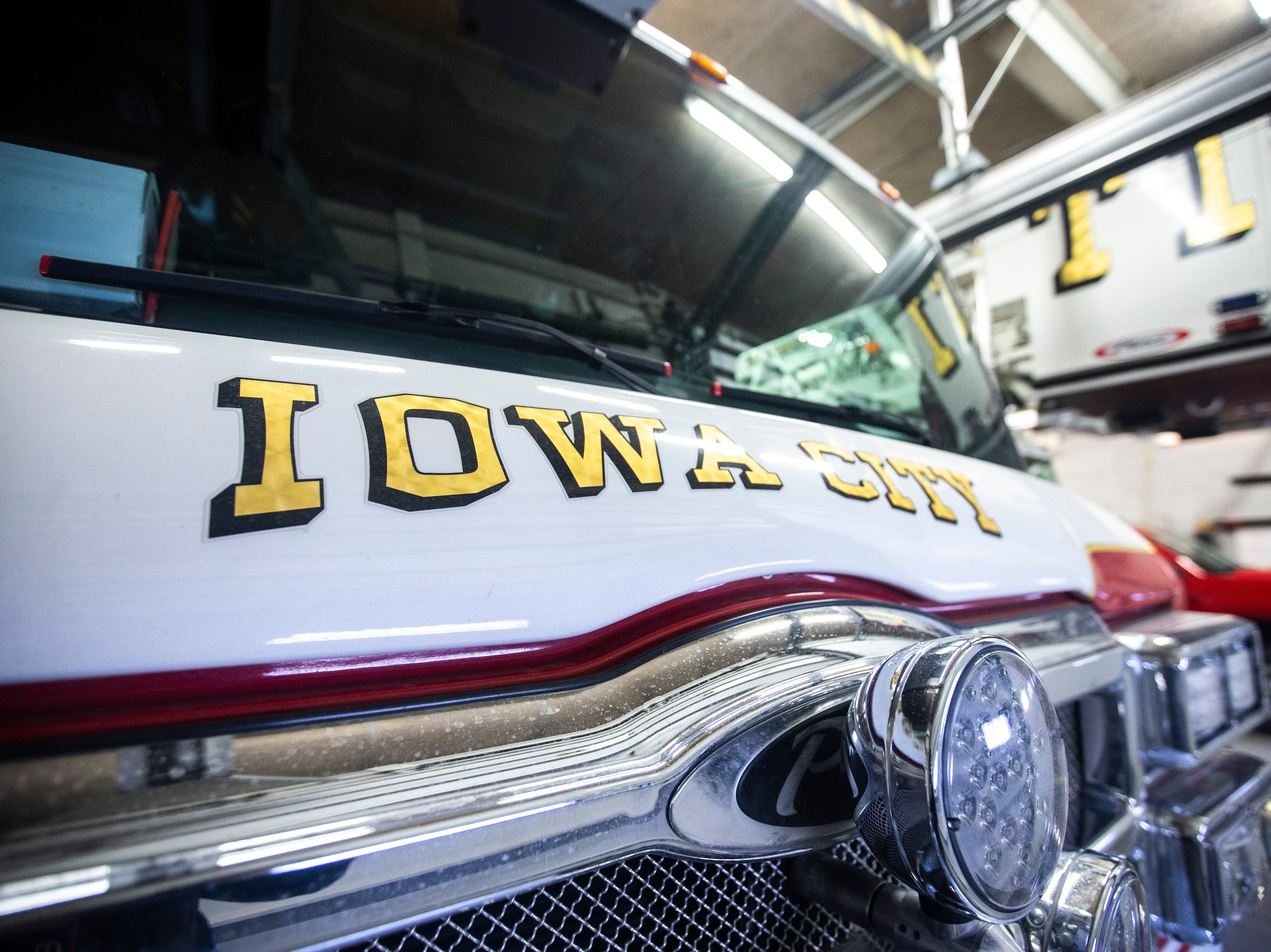 """Iowa City"" is written on the front of Emergency 1, the primary response vehicle used at the Iowa City Fire Deparment's central station, on Thursday, March 7, 2019, inside Fire Station No. 1, at 10 South Gilbert Street in downtown Iowa City, Iowa. The station was opened January 1, 1961, the same day the previous station of 80 years was retired."