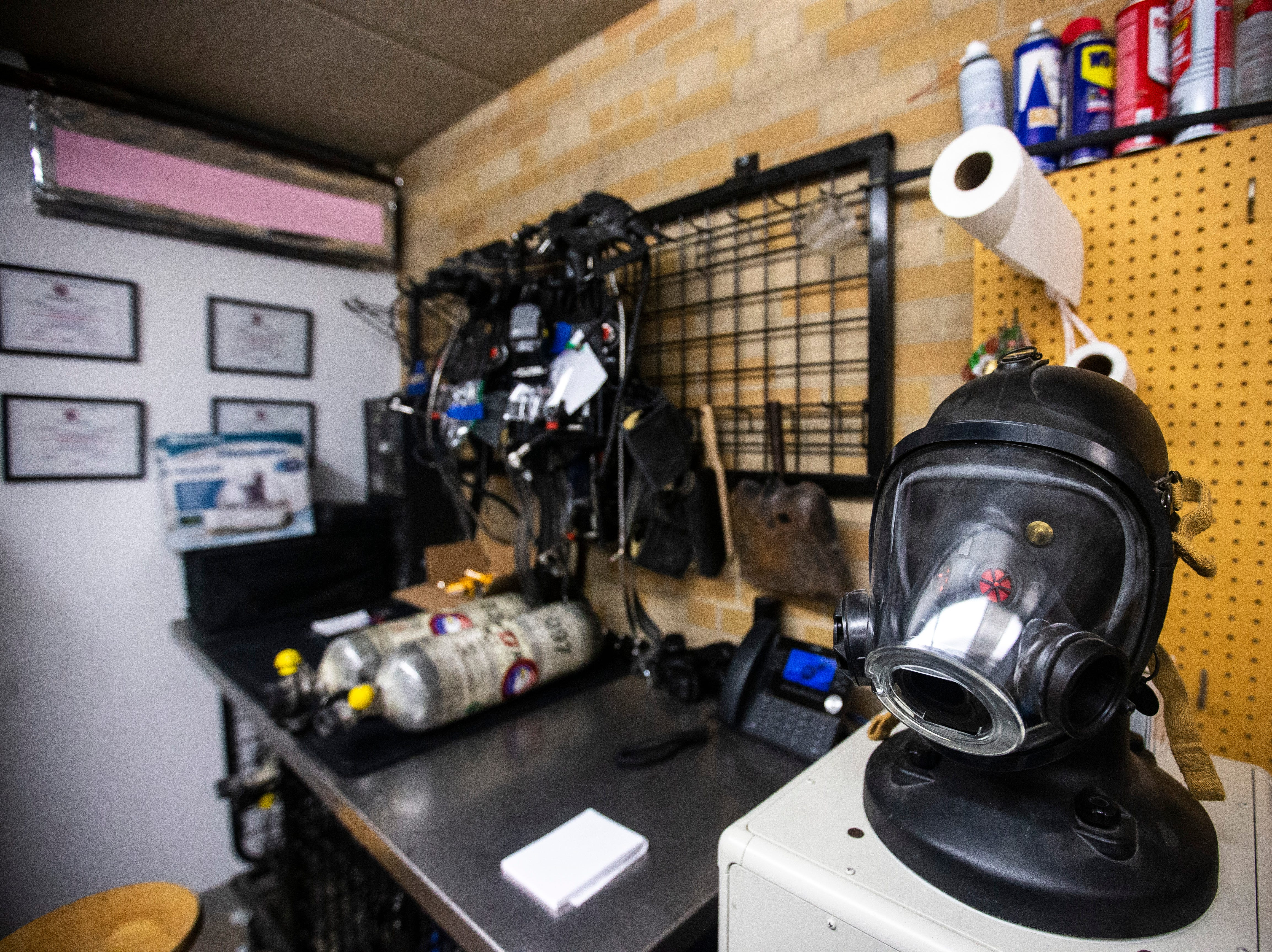 A mask sits on a testing machine on Thursday, March 7, 2019, inside Fire Station No. 1, at 10 South Gilbert Street in downtown Iowa City, Iowa. Iowa City tests their masks at least once a year for pressure seals and safety.