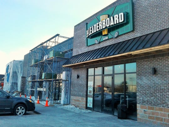 The Leaderboard indoor golf and game bar is now open at this new strip mall along Highway 965 in North Liberty.  Scaffolding shown here indicates that construction on the rest of the mall is still underway