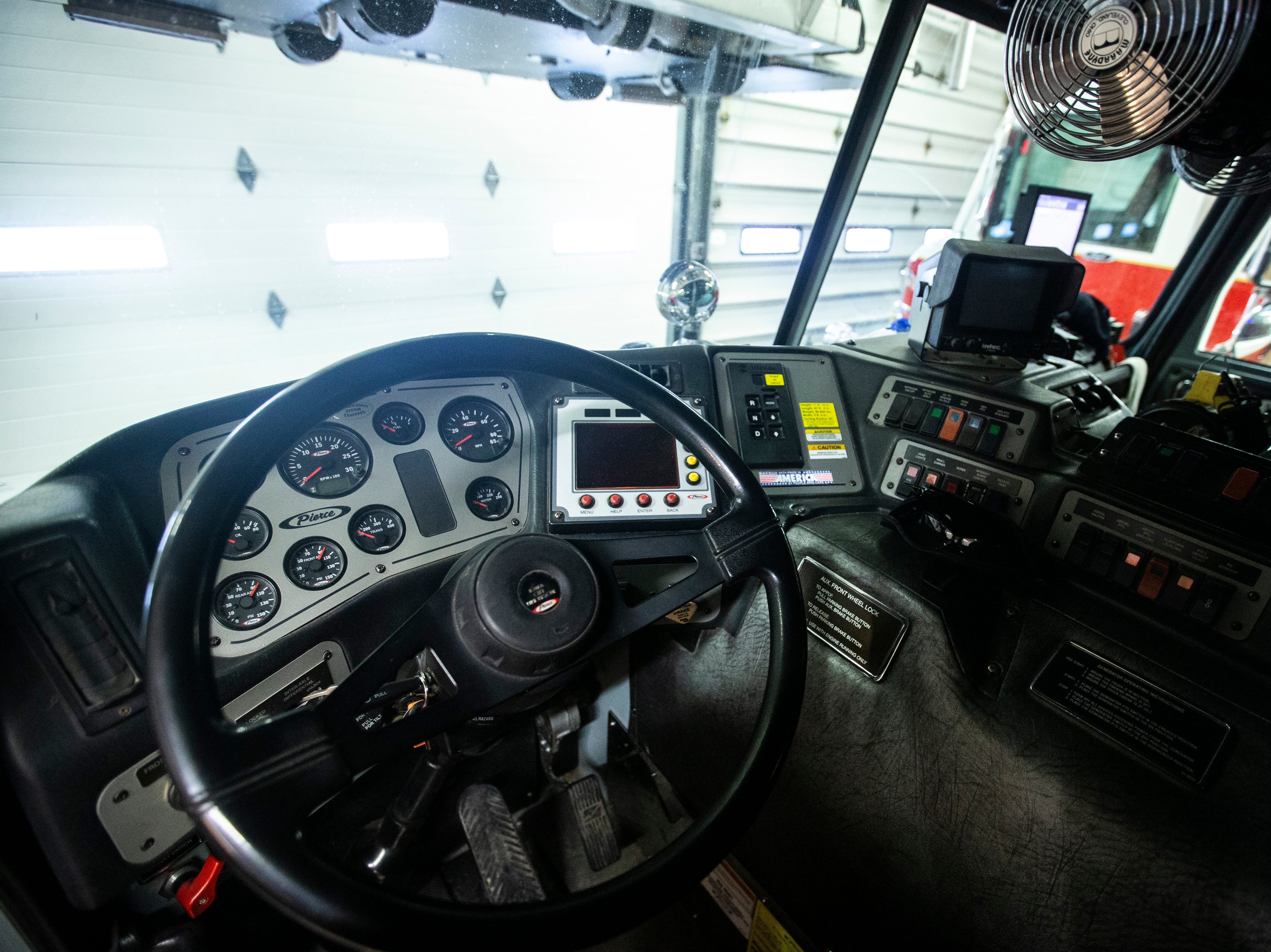 The cab inside Truck 1, a 102-foot Gruman Aerial Cat platform ladder truck, on Thursday, March 7, 2019, inside Fire Station No. 1, at 10 South Gilbert Street in downtown Iowa City, Iowa.