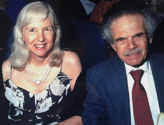 This 2004 photo shows Erwin Kleinfeld and his late wife Margaret, known as Peggy, enjoying a social event.  The former Iowa City couple taught in the University of Iowa Math Department for 34 years.