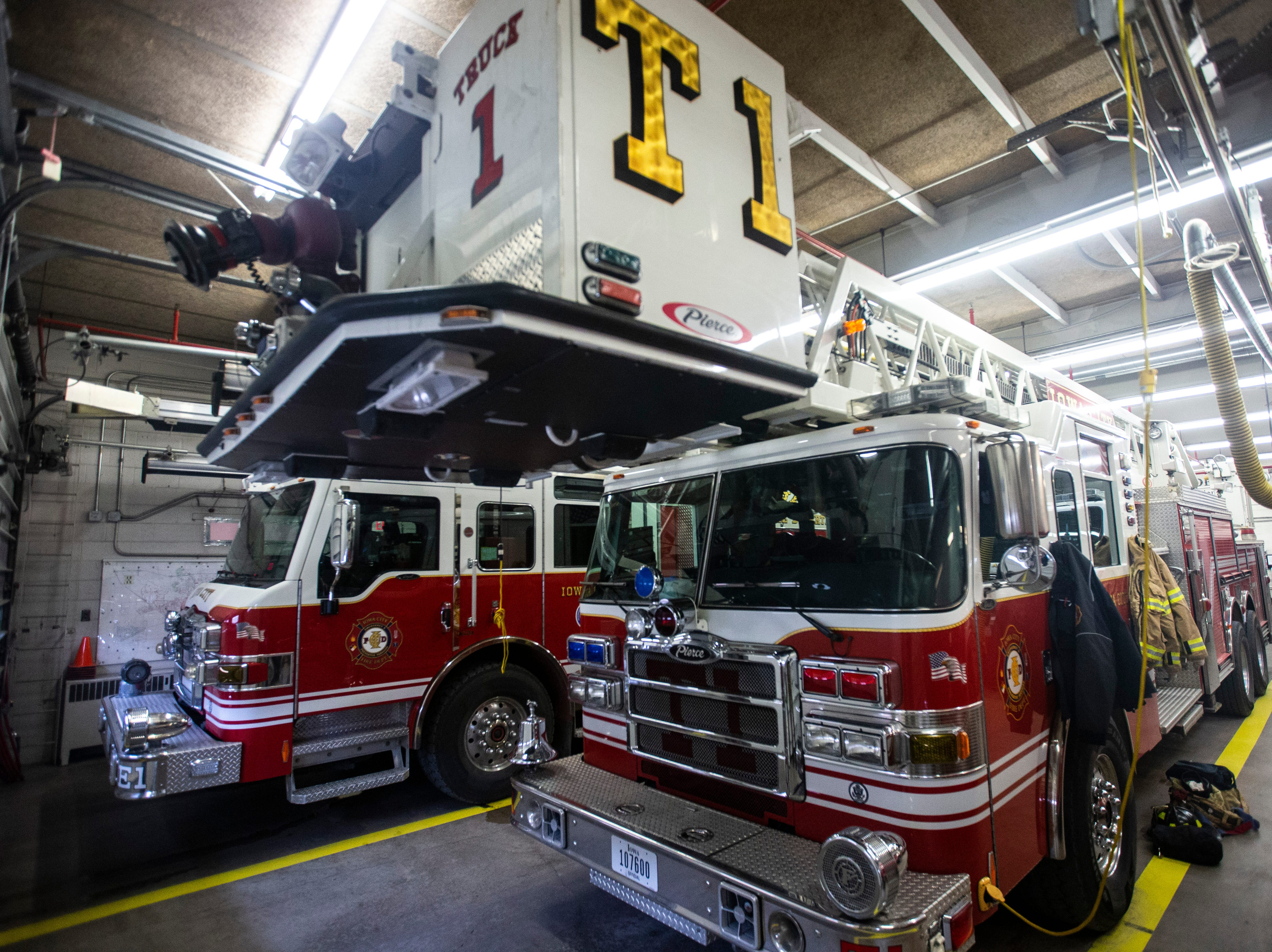 Truck 1, an Iowa City Fire Department 102-foot Gruman Aerial Cat platform ladder truck, sits in the garage on Thursday, March 7, 2019, inside Fire Station No. 1, at 10 South Gilbert Street in downtown Iowa City, Iowa.