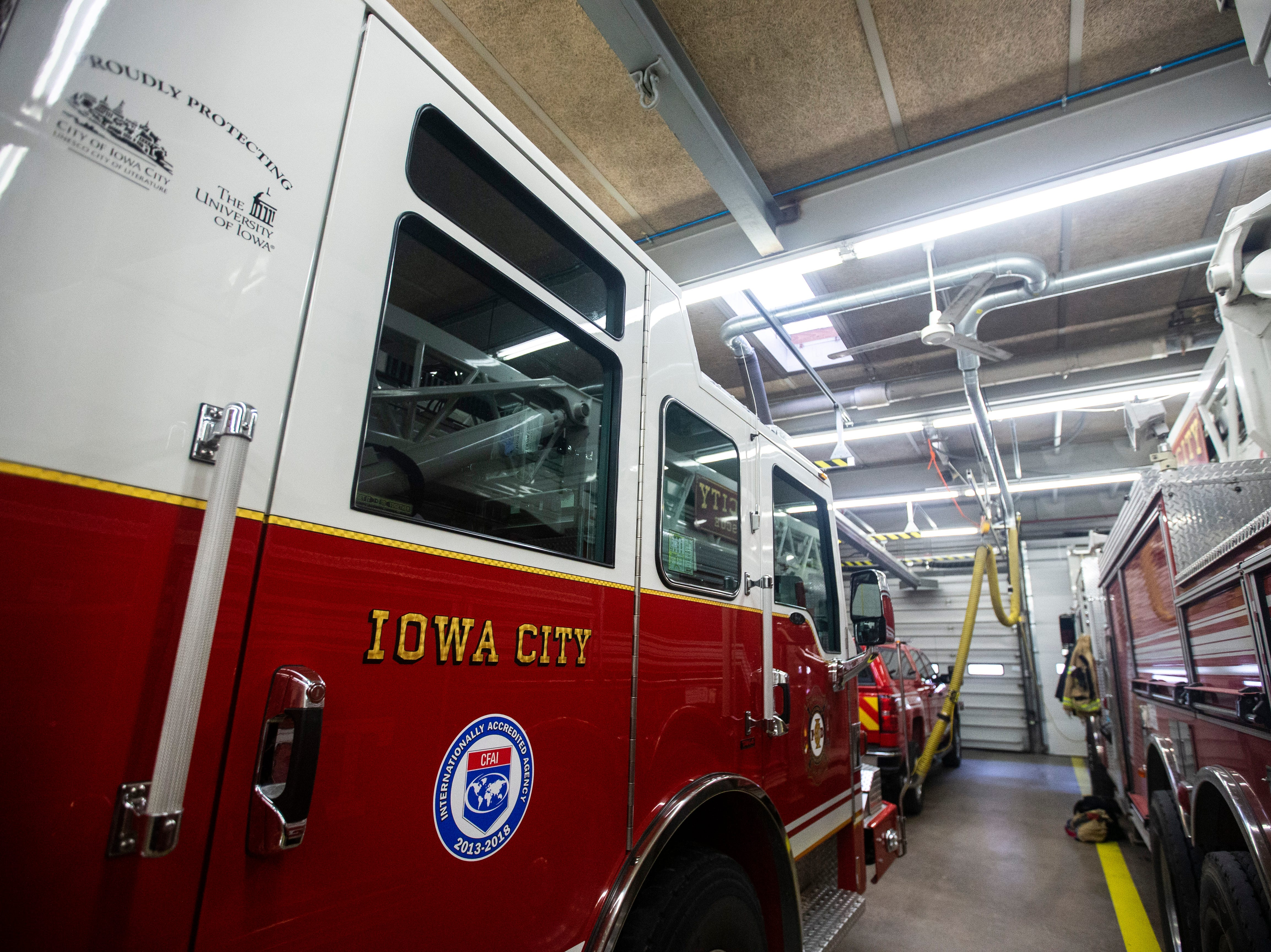 "A decal featuring the logos of the City of Iowa City and the University of Iowa has the inscription, ""proudly protecting"" written over it on the side of a vehicle on Thursday, March 7, 2019, inside Fire Station No. 1, at 10 South Gilbert Street in downtown Iowa City, Iowa."