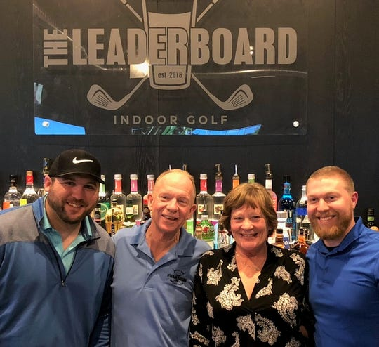 North Liberty residents (from left) Josh Smith, John O'Neill, Yvonne O'Neill and Grant Uding have launched The Leaderboard, North Liberty's new indoor golf and game bar across from Penn Landing.  The new business features five state-of-the-art golf simulator bays, plus pool, darts and other games.