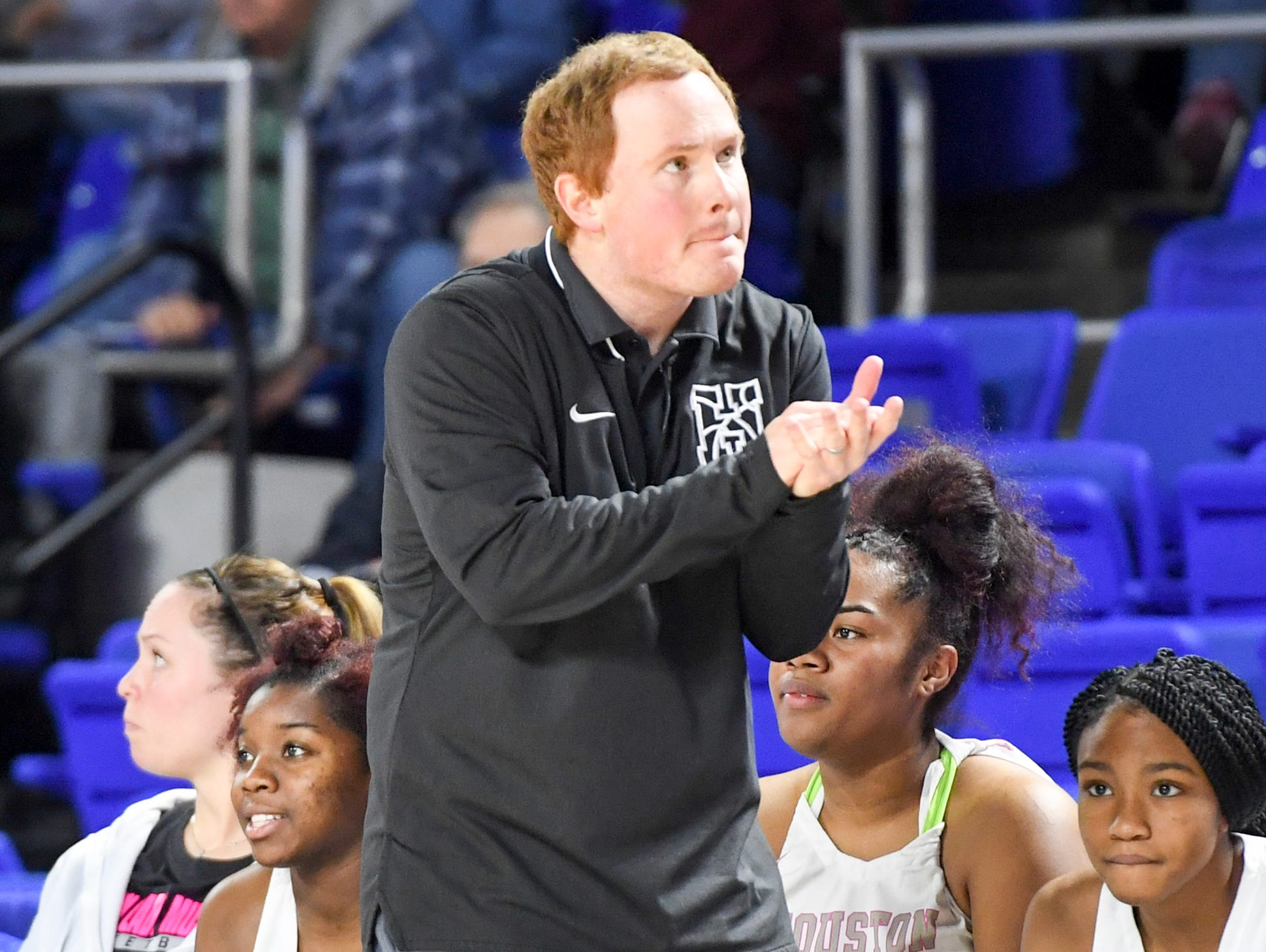Houston's head coach Ben Moore claps as the seconds wind down during their Class AAA quarterfianl game against Mt. Juliet, Wednesday, March 6, 2019, in Murfreesboro. Houston defeated Mt. Juliet, 65-58.