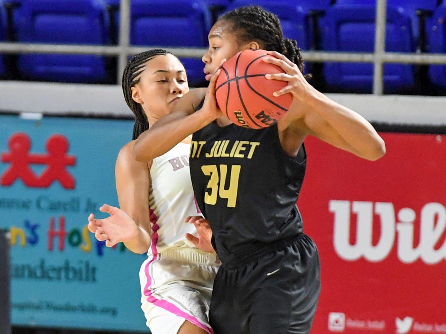 Houston's Madison Griggs (23) guards Mt. Juliet's Tondriannha Davis (34) during their Class AAA quarterfianl game, Wednesday, March 6, 2019, in Murfreesboro.