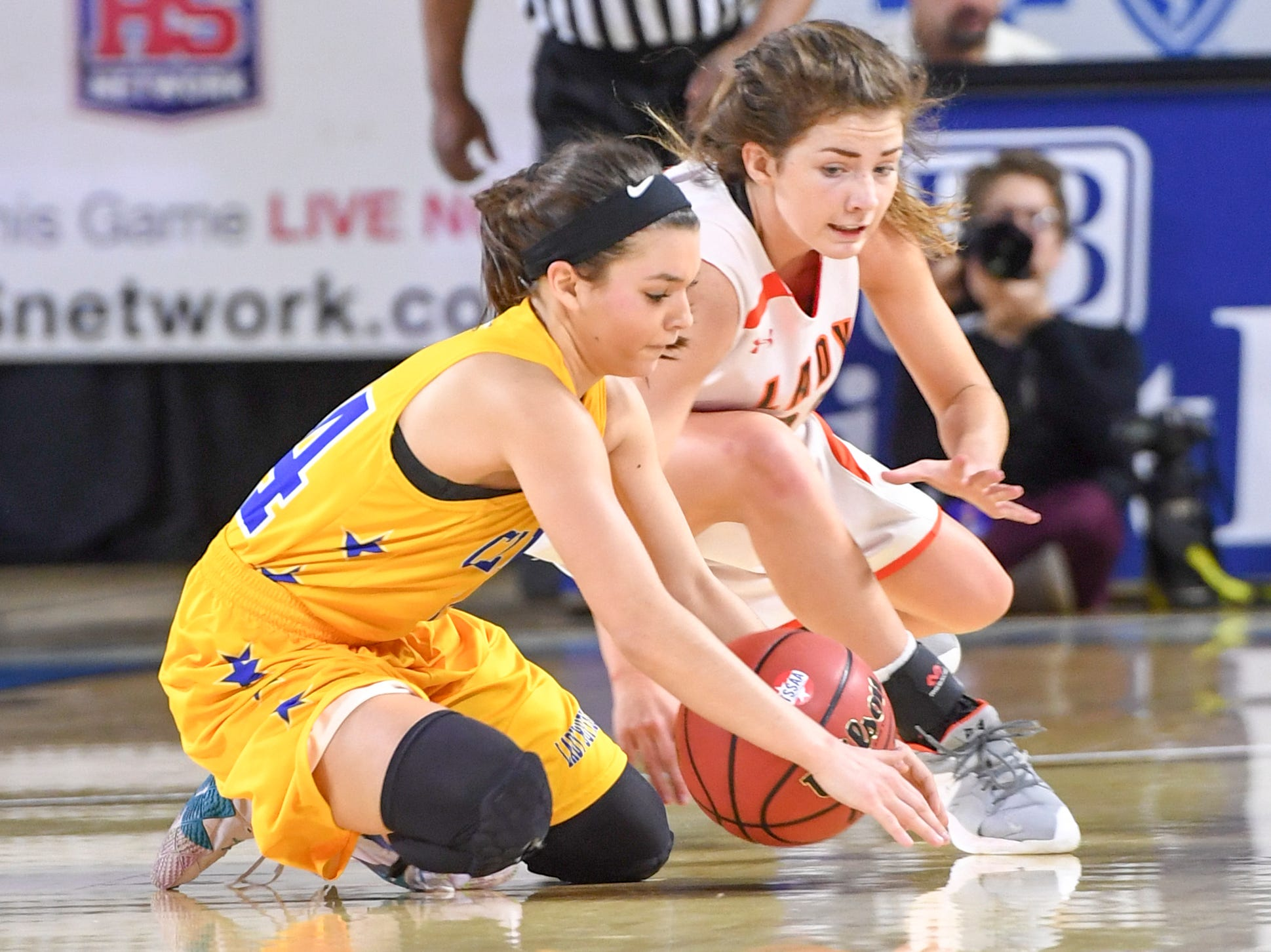Greenfield's Edie Darby (23) and Clarkrange's Kaylie Monday (24) fall to the ground to possess a loose ball during their Class A quarterfinal game, Thursday, March 7, 2019, in Murfreesboro.