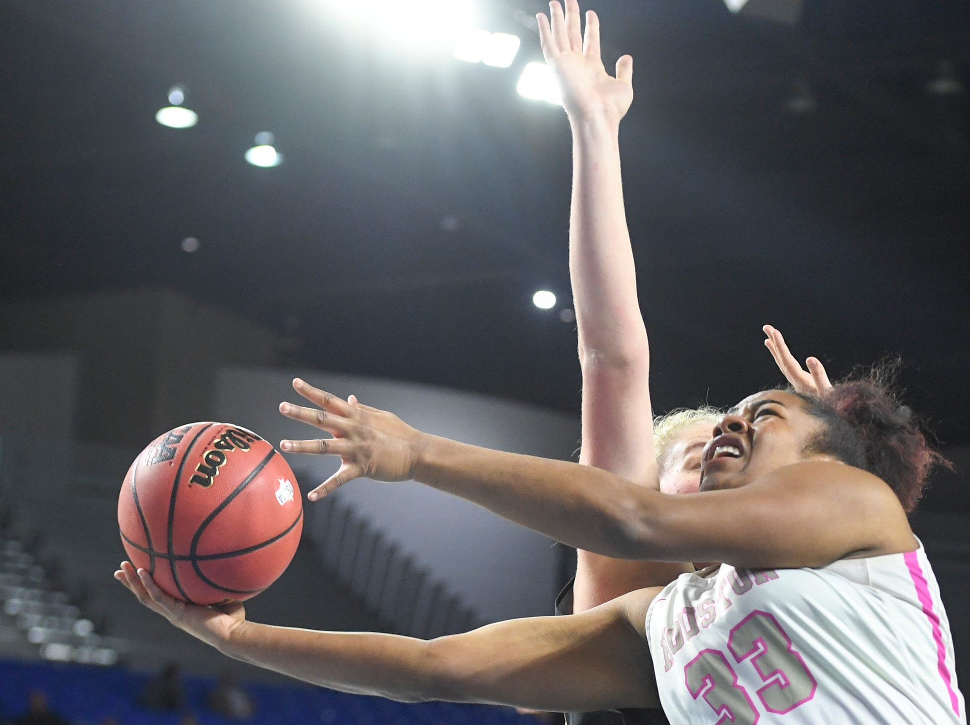 Houston's Melisa Carter (33) goes up and under a Mt. Juliet defender during their Class AAA quarterfianl game, Wednesday, March 6, 2019, in Murfreesboro.