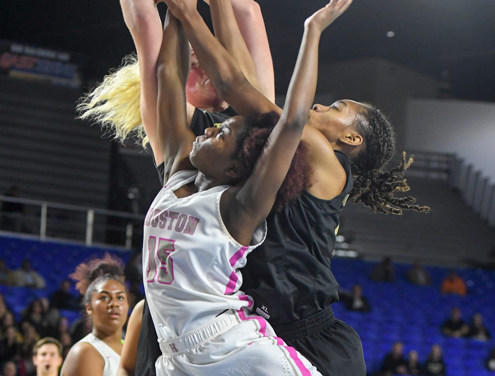 Houston's Zipporah Davis (15) attempts to get a rebound over two Mt. Juliet defenders during their Class AAA quarterfianl game, Wednesday, March 6, 2019, in Murfreesboro.