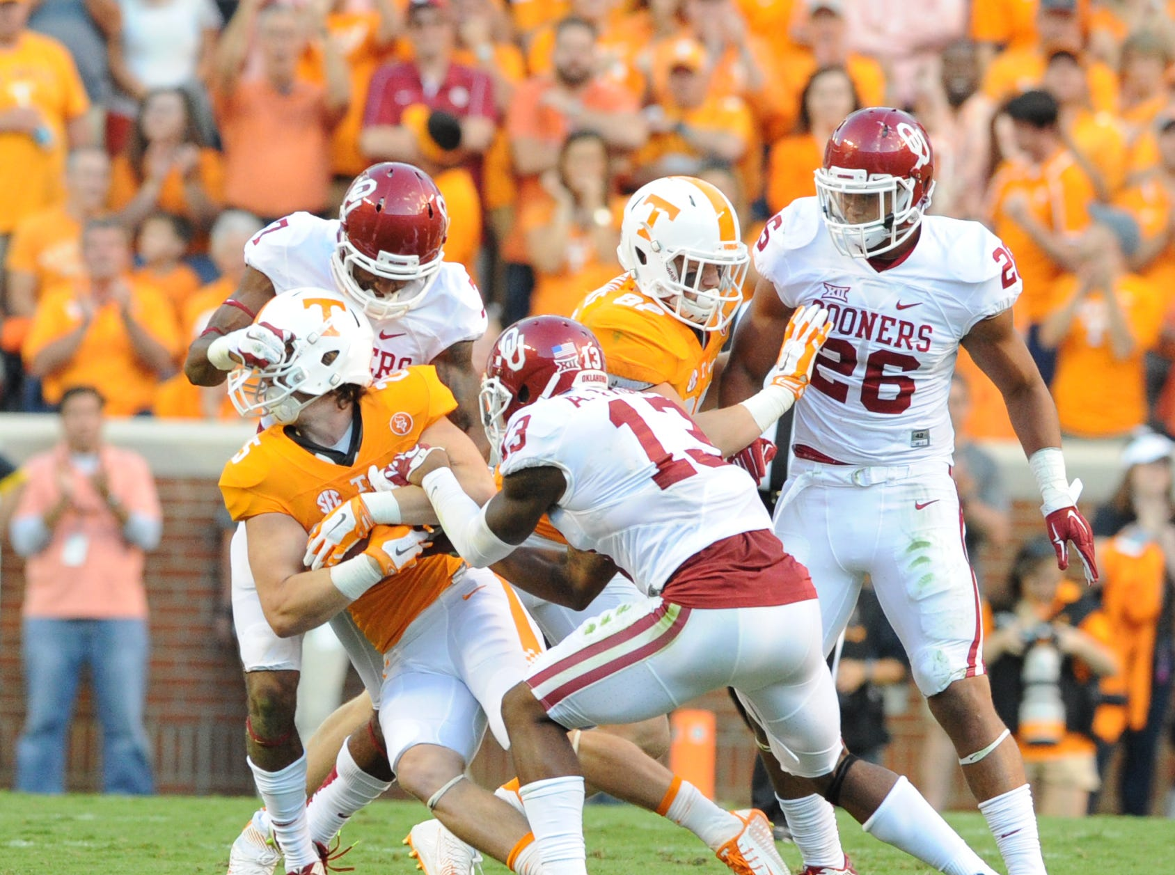 Tennessee wide receiver Josh Smith (25) is pressured by Oklahoma defenders Jordan Thomas (7) and Ahmad Thomas (13) during the first half at Neyland Stadium on Saturday, Sept. 12, 2015 in Knoxville, Tenn.