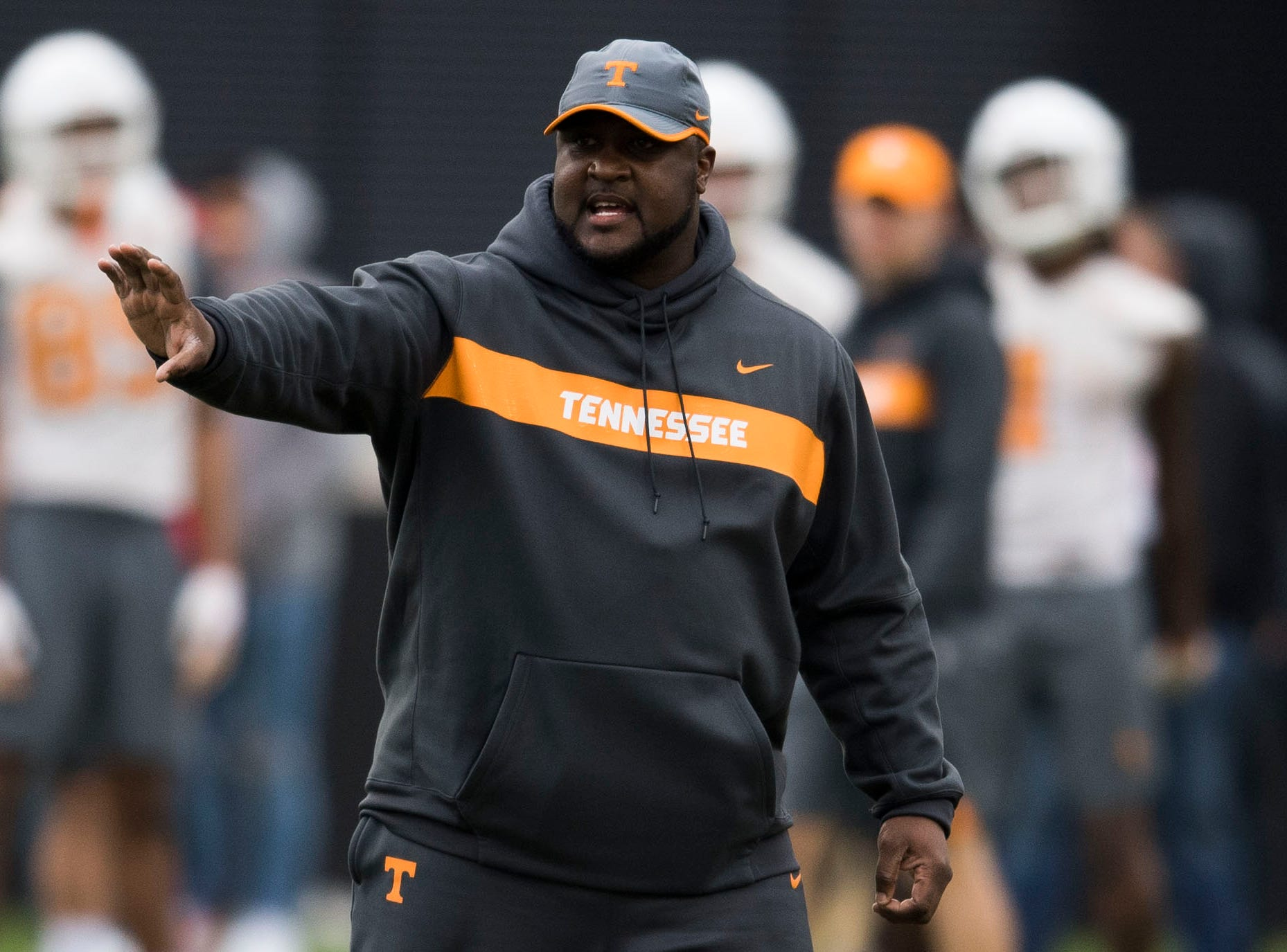 Assistant head coach Tee Martin coaches during Tennessee football's first practice of the spring season at University of Tennessee Thursday, March 7, 2019.