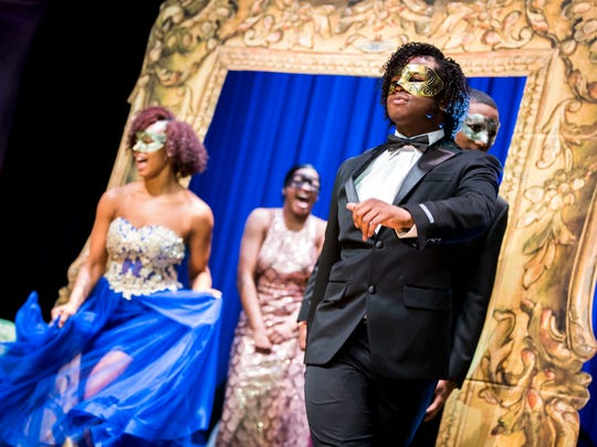 The Austin-East High prom committee takes the stage in prom wear after Belk announced they will be covering the prom expenses—tickets, dresses, formal wear, hair, makeup and more—for the senior class during an event held at Austin-East on Thursday, March 7, 2019.