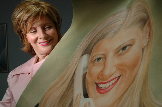 In this 2006 picture, Jacqueline Dawes poses with a painting of her daughter who died of an ecstasy overdose. Dawes founded the women-specific addiction treatment/mental health center Brookhaven Retreat in Seymour, offering detox, addiction and mental-health services. She closed it abruptly Tuesday.