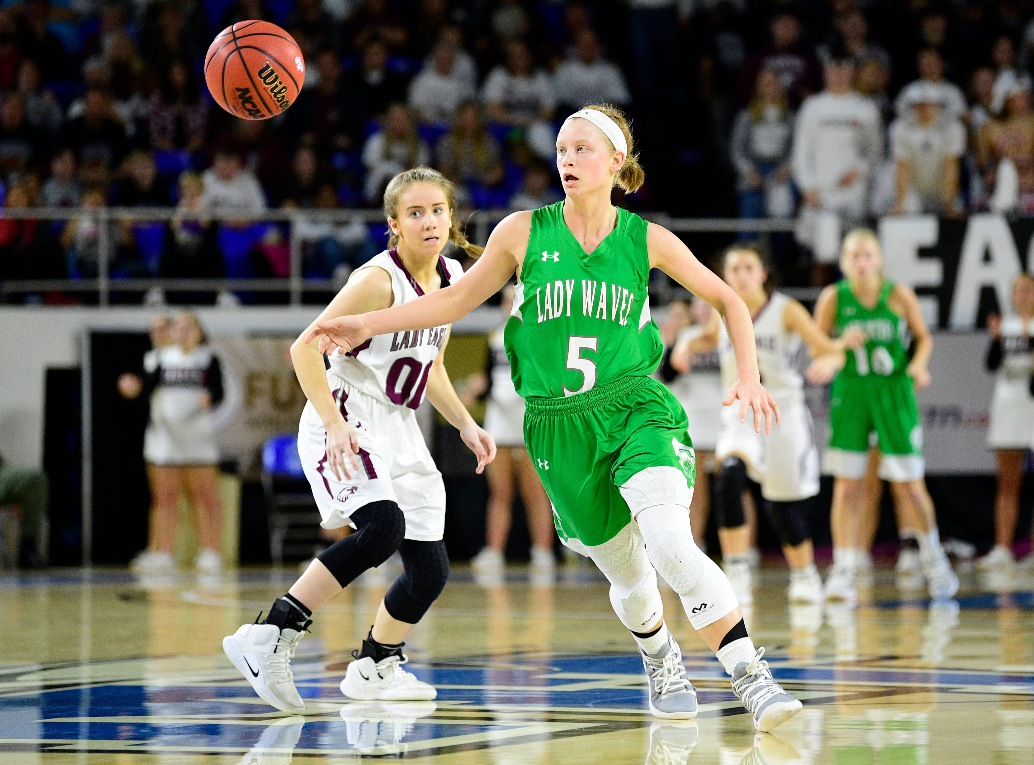 Midway's Paige Bacon (5) and Eagleville's Haylee Ferguson (00) chase the ball during a game between Eagleville and Midway at the TSSAA girls state tournament at the Murphy Center in Murfreesboro, Tennessee on Thursday, March 7, 2019.