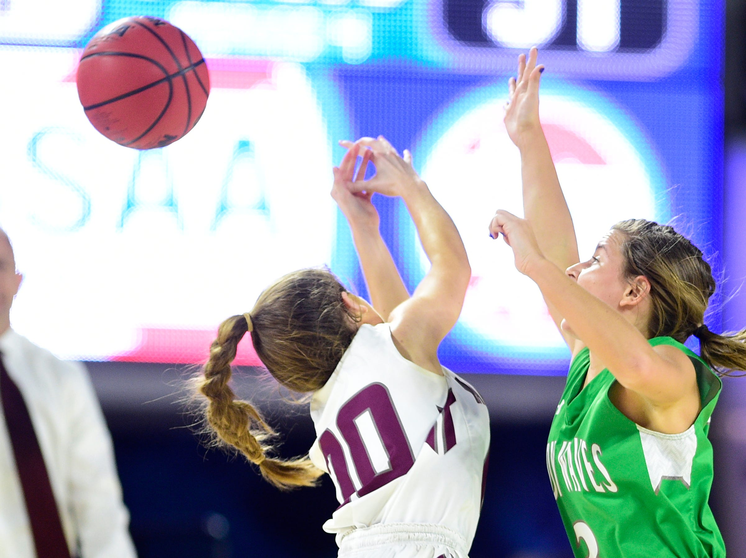 Midway's Rebecca Lemasters (3) blocks Eagleville's Haylee Ferguson (00) during a game between Eagleville and Midway at the TSSAA girls state tournament at the Murphy Center in Murfreesboro, Tennessee on Thursday, March 7, 2019.