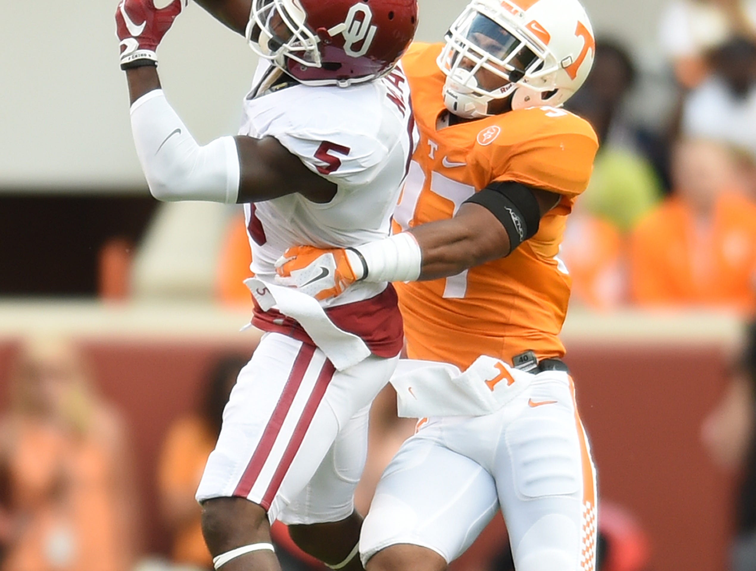 Tennessee defensive back Brian Randolph (37) breaks up a pass intended for Oklahoma wide receiver Durron Neal (5) during the first half on Saturday, Sept. 12, 2015.