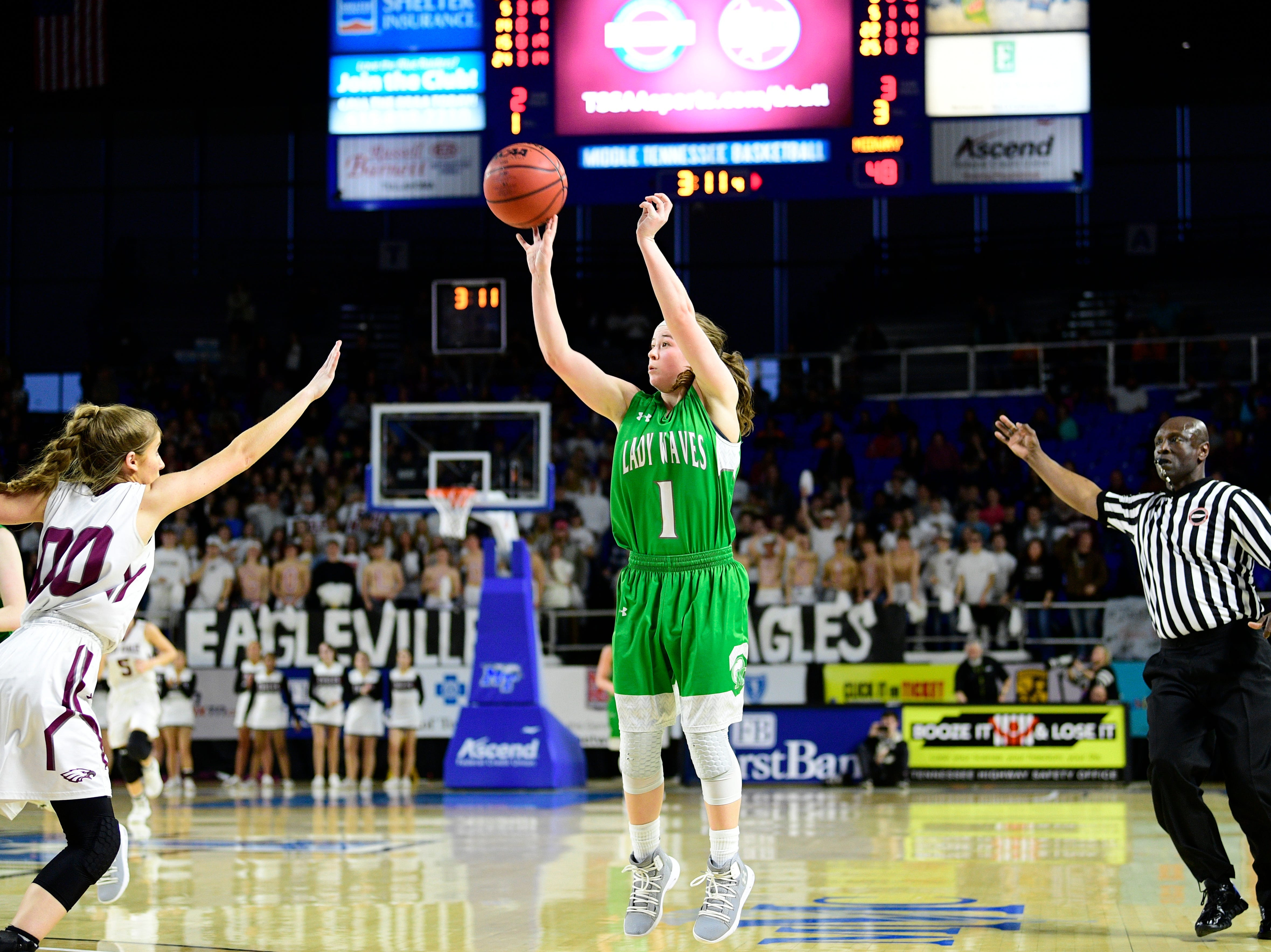 Midway's Caitlyn Ross (1) shoots a three point shot during a game between Eagleville and Midway at the TSSAA girls state tournament at the Murphy Center in Murfreesboro, Tennessee on Thursday, March 7, 2019.