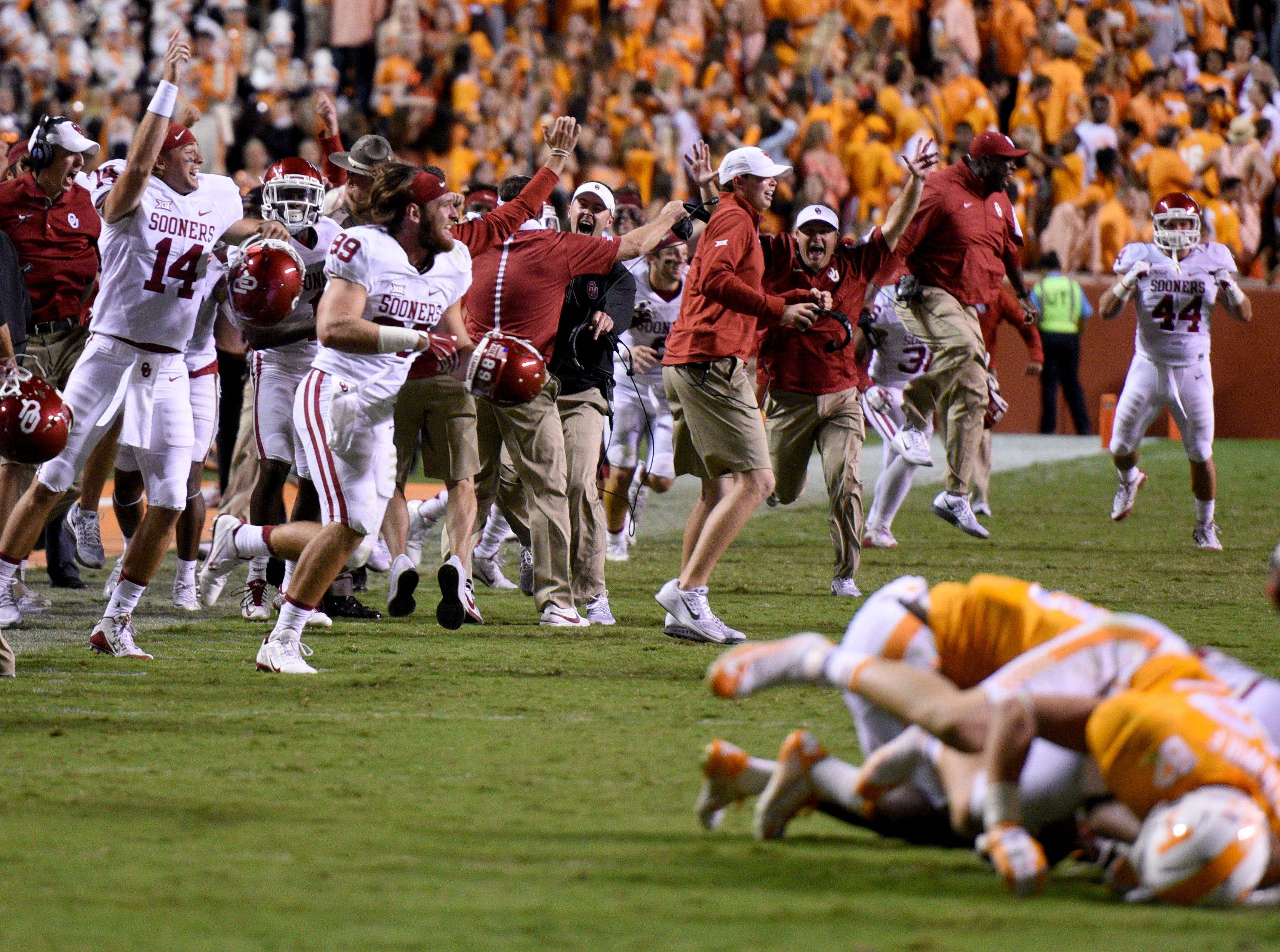 Oklahoma players and coaches celebrate after a 31-24 victory in overtime at Neyland Stadium on Saturday, Sept. 12, 2015 in Knoxville, Tenn.