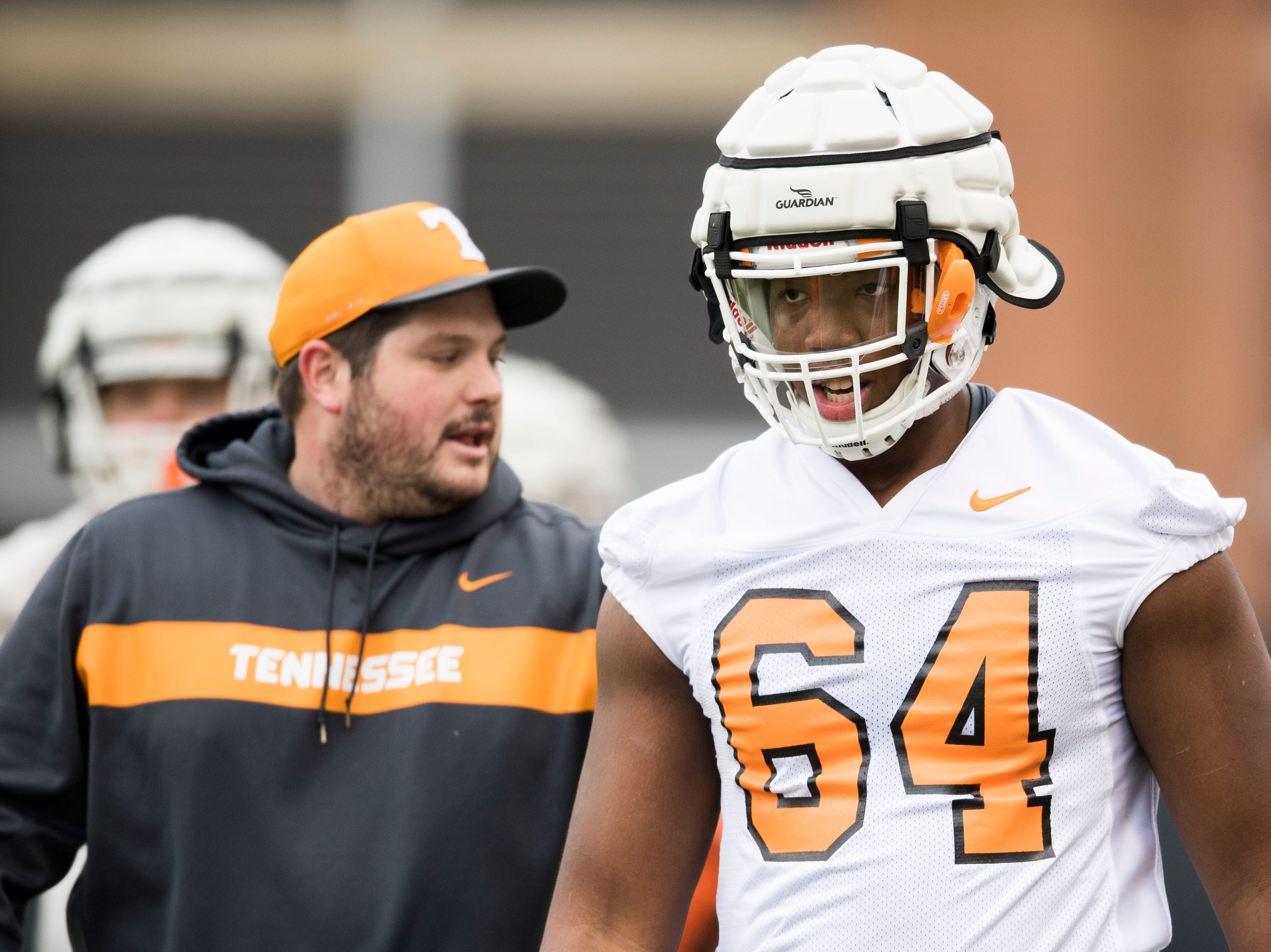 Tennessee's Wanya Morris (64) participates in a drill during Tennessee football's first practice of the spring season at University of Tennessee Thursday, March 7, 2019.