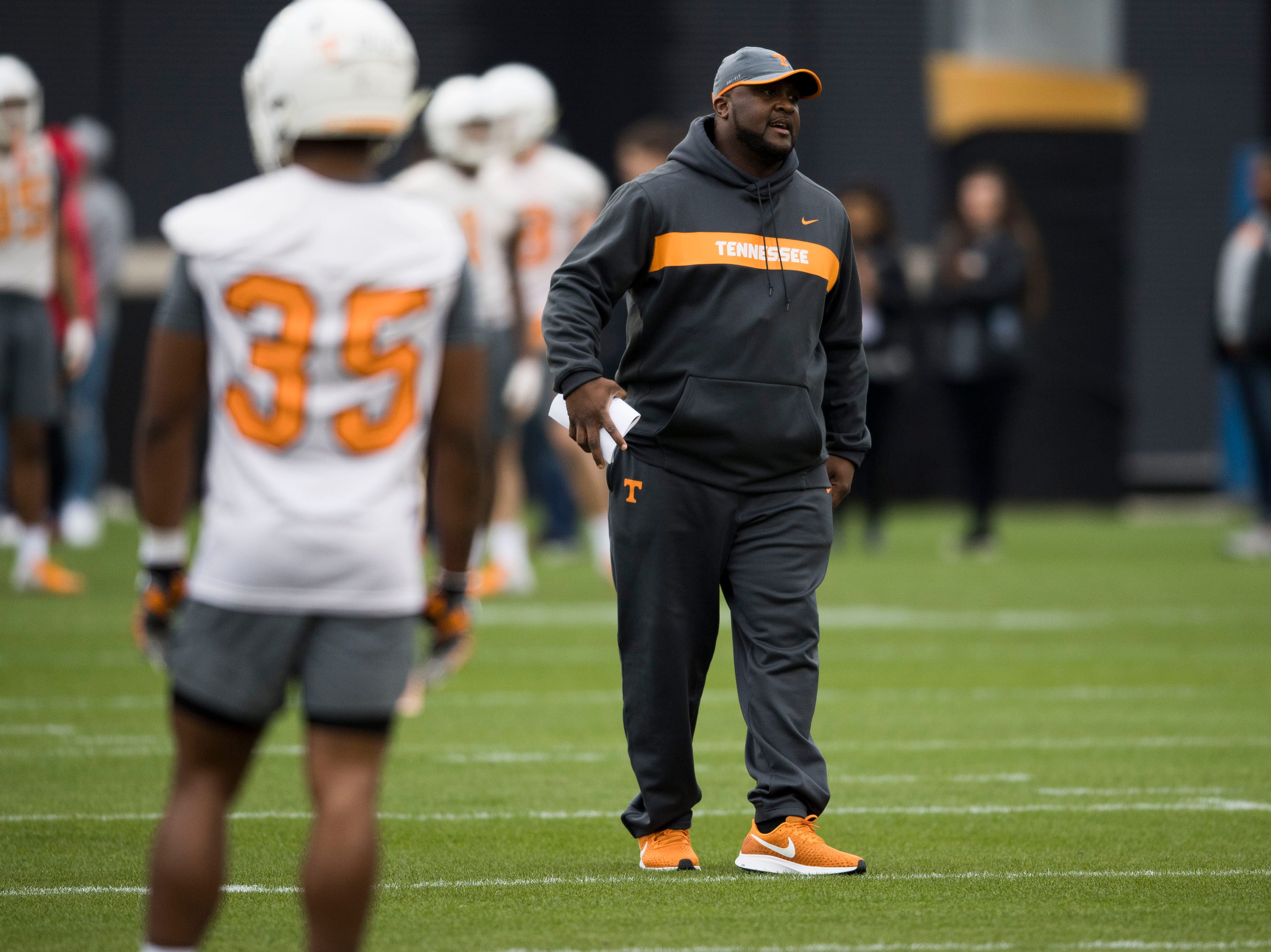 Assistant head coach Tee Martin walks on the field during Tennessee football's first practice of the spring season at University of Tennessee Thursday, March 7, 2019.