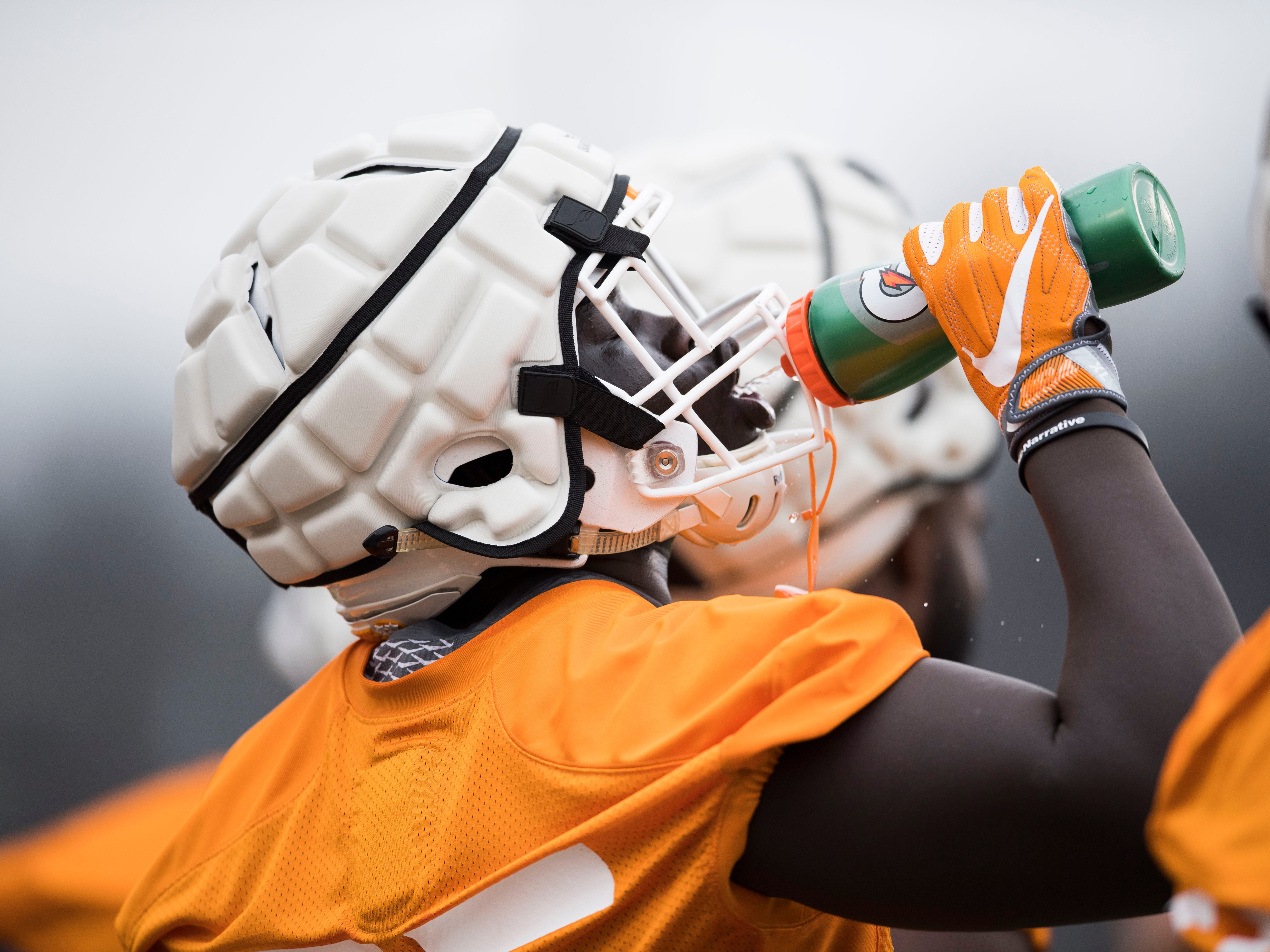 A player takes a drink during Tennessee football's first practice of the spring season at University of Tennessee Thursday, March 7, 2019.