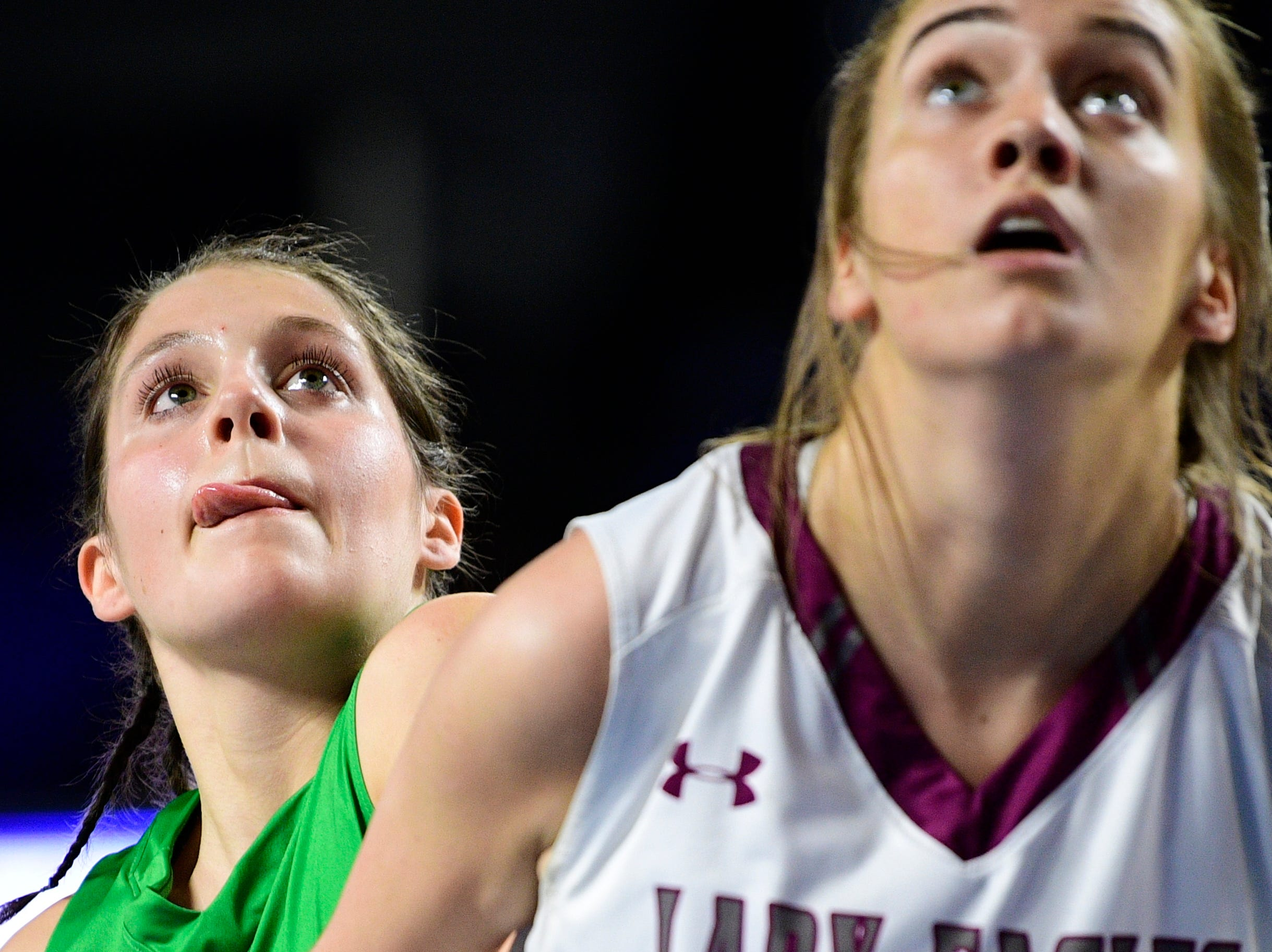 Midway's Emmy Taylor (25) and Eagleville's Coley Whitley (4) the ball during a game between Eagleville and Midway at the TSSAA girls state tournament at the Murphy Center in Murfreesboro, Tennessee on Thursday, March 7, 2019.