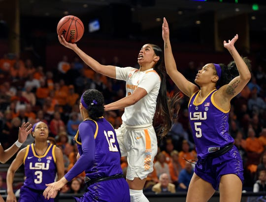 Tennessee's Evina Westbrook shoots past LSU's Ayana Mitchell (5), Mercedes Brooks (3) and (12) Khayla Pointer during the first half of Thursday's game.