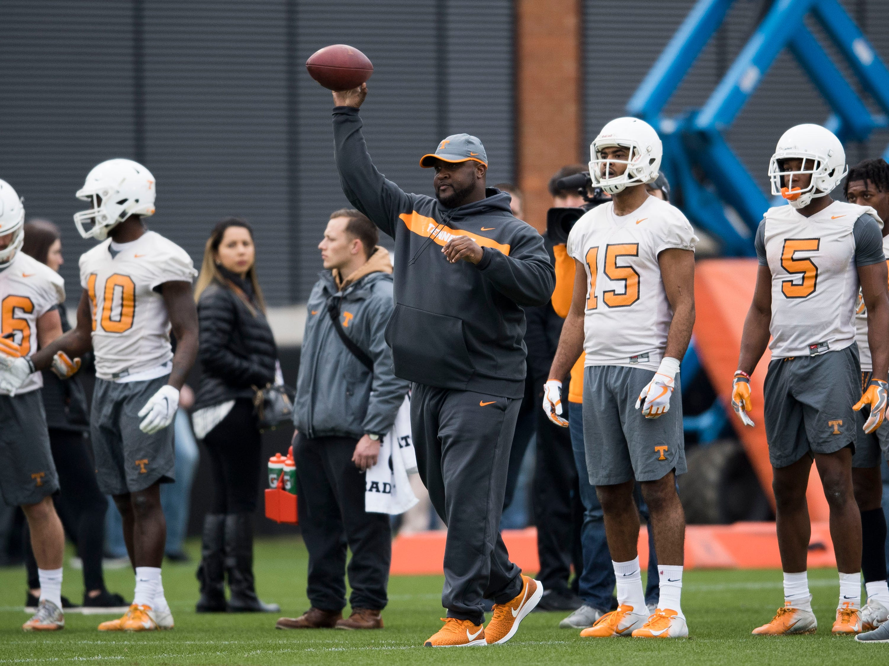 Assistant head coach Tee Martin throws the ball during Tennessee football's first practice of the spring season at University of Tennessee Thursday, March 7, 2019.