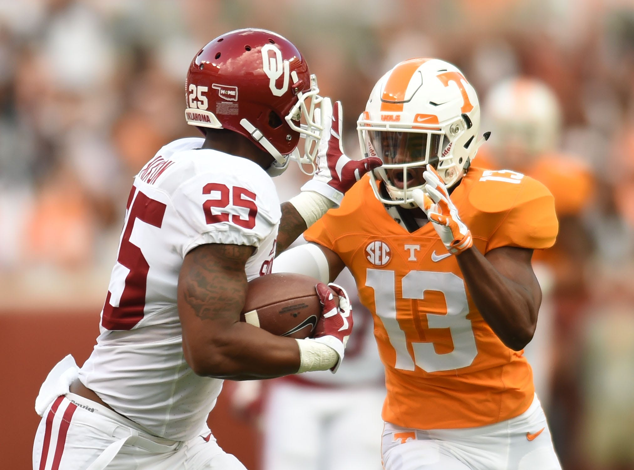 Oklahoma running back Joe Mixon (25) tries to move past Tennessee defensive back Malik Foreman (13) during the first half at Neyland Stadium on Saturday, Sept. 12, 2015 in Knoxville, Tenn.